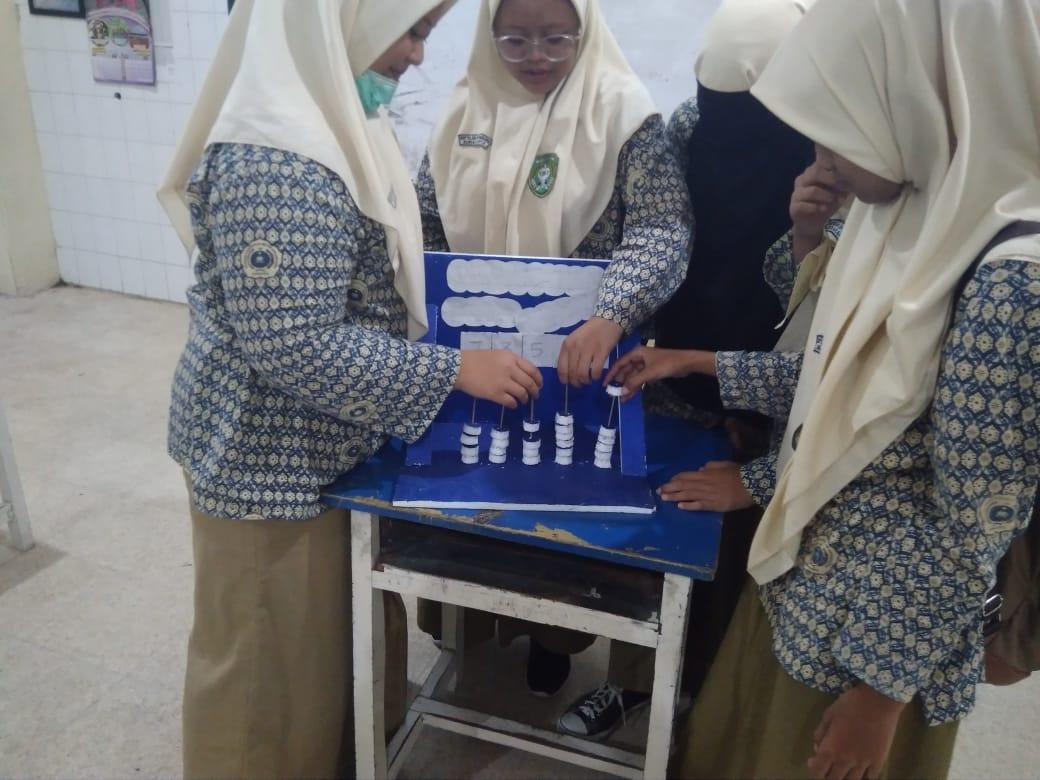 Efektivitas Alat Peraga Dalam Pembelajaran Matematika Kelas IX D (Pemanfaatan PANTIK untuk Pembelajaran Statistika)